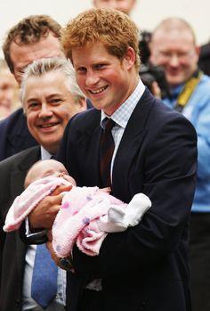 Pin for Later: Comment Harry S'est Transformé de Petit Garçon à Véritable Prince  Harry était tout sourire en tenant un nouveau né dans ses bras à l'University Hospital of Wales en Juin 2008.