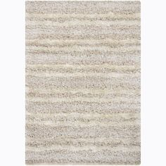 Bring a new look to your home decor with this Mandara shag rug. Hand woven in India and features shag pattern in shades of ivory.