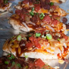 Monterey Chicken Recipe ~    4 boneless, skinless chicken breasts   ;     1/4 cup bar-b-que sauce   ;    1/4 cup real bacon bits   ;    1 cup cheddar/monterey jack cheese, shredded  ;    1 14 oz. can diced tomatoes, drained   ;    1 5 oz can fire roasted green chiles   ;    sliced green onions