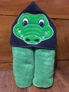 A personal favorite from my Etsy shop https://www.etsy.com/listing/243920694/aligator-hooded-towel
