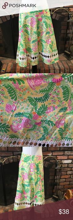 Lilly Pulitzer a-line fruit & animal print skirt Lilly Pulitzer a-line fruit & animal print skirt .  Gorgeous a-line skirt.  Size 2.  Monkeys, turtles and fruit print.  Beautiful white lace cutout trim.  Excellent condition.  30 inch waist 23 inch length. Lilly Pulitzer Skirts A-Line or Full
