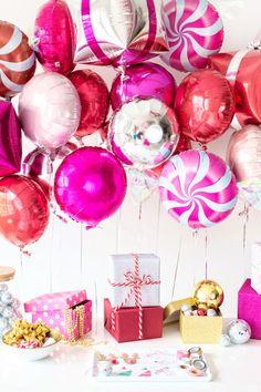 A Goodies + Gift Wrap Holiday Party (+ DIY Present Balloons!) | studiodiy.com