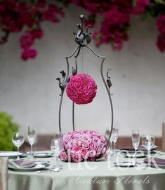 Beautiful vintage flower ball arrangement! Love the hanger basket thingy
