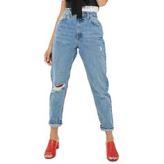 Women's Topshop Ripped Mom Jeans ($75) ❤ liked on Polyvore featuring jeans, mid denim, ripped denim jeans, high rise jeans, ripped jeans, distressed denim jeans and destroyed denim jeans