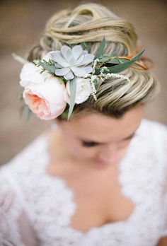 A fresh new wedding hairstyle with a succulent | Brides.com
