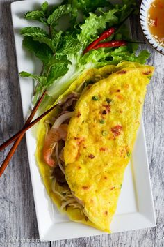 Vietnamese Crepe (Banh Xeo) is thin, crispy and filled with shrimp, pork, and crunchy vegetables. This delicious crepe is quick and easy to make. Serve it with fresh herbs and refreshing dipping sauce as a snack, appetizer or main dish. #vietnamese #crepe
