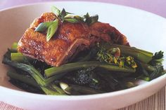 Succulent tender roast duck in an Asian inspired marinade is a great choice with steamed choy sum and shallots.