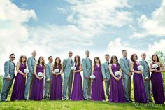 plum purple and grey. With the huge trend of more relaxed and casual weddings, groomsmen have recently been opting for lighter colored suits recently. While the days of the black and white tuxedo aren't totally gone, it's so refreshing to see this color on the guys