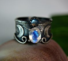 Natural faceted oval Moonstone mixed with Labradorite set in solid sterling silver.