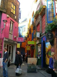 London - Neal's Yard is a small alley in Covent Garden between Shorts Gardens and Monmouth Street which opens into a courtyard. Named after 17th century developer, Thomas Neale, it contains several unique shops and cafes.