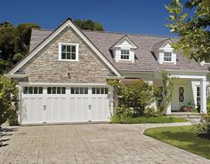 Give your home romantic cottage charm with a white carriage house garage door. Model shown: Clopay Coachman Collection steel and composite carriage house garage door, Design 13, REC14 windows in white. www.clopaydoor.com.