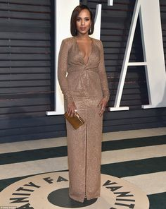 Radiant! Kerry Washington, 40, flashed her cleavage in a plunging gold sequinned gown...
