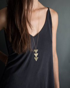 """Long Geometric Necklace Triangles Pendant Necklace // Triangle necklace: arrow necklace, """"NEFERTITI NECKLACE"""" is a simple long necklace with a stack of three raw brass triangles. Long necklaces are great, but you can also wear this one short. Short Necklace, Simple Necklace, Simple Jewelry, Modern Jewelry, Metal Jewelry, Necklace Lengths, Gold Jewelry, Gucci Jewelry, Long Pendant Necklace"""