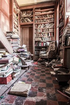 The Library in the abandoned Chateau de la Foret, Belgium. The original building was built in 1502, but much of the original house and feudal fortress was replaced in 1860 by the current building. There was a secret staircase which led from the bathroom to the library.  The current castle was built in a neo-Tudor style.  It has been unoccupied since 1991.  Photo: tumblr.com/post/coisasdetere