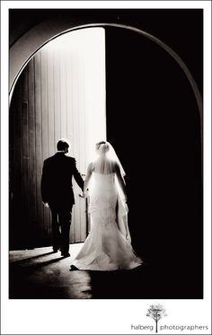 Bride and groom walking through our grand Chai doors at Chateau Julien. www.chateaujulien.com  Beautiful photo by Halberg Photographers""