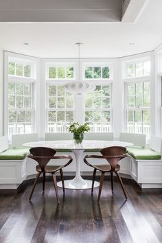 Cute Oval Saarinen Table Image Decor in Dining Room Transitional design ideas with Cute banquette breakfast nook centerpiece curved bench curved wall pendant light tulip table