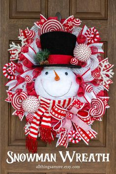 Who doesn't love a snowman wreath for Christmas? This snowman wreath is made on a wire frame accented by red and white mesh. The snowman head is definitely the center of attention! Gorgeous ribbons, glittered snowflakes, lollipops, ornaments and candy cane picks are the icing on this sweet snowman wreath. This would be an adorable edition to your home decor this Christmas all the way through winter.
