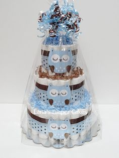 Blue And Brown Owl Diaper Cake Baby Shower Centerpiece by LanasDiaperCakeShop on Etsy https://www.etsy.com/listing/187971980/blue-and-brown-owl-diaper-cake-baby