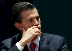 Mexico's President Enrique Pena Nieto reacts during a ceremony to sign into law a new-anti corruption legislation, at the National Palace in Mexico City May 4, 2015.  REUTERS/Henry Romero