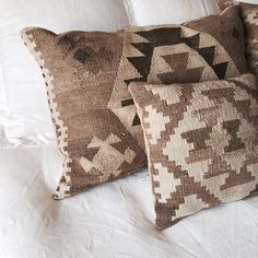 Love the neutral tones of these pillows.