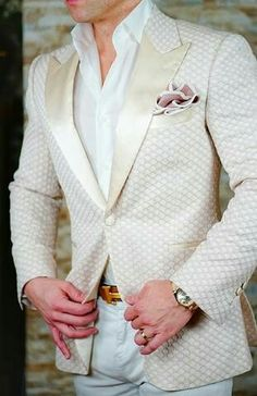 This ivory jacket worn by a groom would compliment any vintage bridal gown