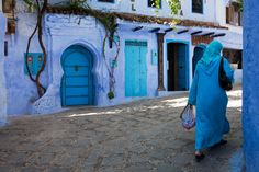 Woman in a blue djellaba walking in the blue city of Chefchaouen Julie Hall, Open Door Policy, Blue City, Slow Travel, Moroccan Design, Beautiful World, Blues, To Go, Architecture
