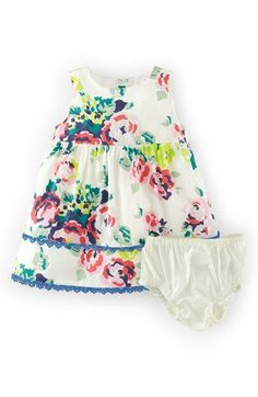 "Free shipping and returns on Mini Boden 'Pretty Tea' Cotton Dress & Bloomers (Baby Girls) at Nordstrom.com. <p><B STYLE=""COLOR:#990000"">Pre-order this style today! Add to Shopping Bag to view approximate ship date. You'll be charged only when your item ships.</b></p><br>Sweet blooms are enhanced by contrast lace trim at the hem of a charming party dress paired with coordinating bloomers."
