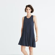 "Made of supersoft jersey with a touch of stretch, this swingy tank dress is ridiculously versatile in easy chevron stripes. Just add shoes et voilà—the two-minute outfit. <ul><li>Nonwaisted.</li><li>Falls 34 1/4"" from highest point of bodice.</li><li>Viscose/poly/cotton.</li><li>Hand wash.</li><li>Import.</li></ul>"