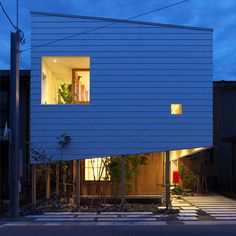Takeru Shoji Architects tops a timber-clad<br /> Japanese house with a…