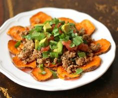 Sweet potato chips with ground turkey taco meat and your favorite nacho toppings! http://stalkerville.net/ #paleo