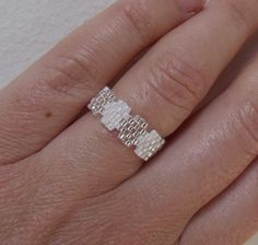 Items similar to Infinity Ring in Shades of White Seed Bead Ring on Etsy Beaded Jewelry Designs, Seed Bead Jewelry, Bead Jewellery, Jewelry Patterns, Bracelet Patterns, Diy Beaded Rings, Beaded Earrings, Diy Crafts Jewelry, Handmade Jewelry