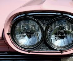 The headlights of an old car at a classic car show on Southsea Common in 2011.