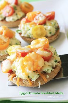 Easy open faced breakfast sandwiches made on a whole wheat English muffin with egg whites and scallions, then topped with heirloom tomatoes and melted cheese - mmm!