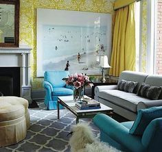 Chartreuse wallpaper - yes please. And that grey sofa is divine. Check out the button tuft on the arm rolls! Moroccan themed floor rug, turquoise chairs. All kinds of win.