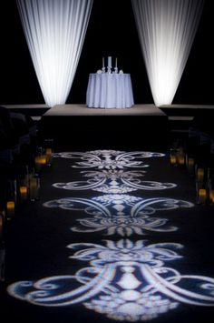 Love the combination of #gobolighting with white #uplights on the sides of the ceremony area. Elegant. DIY and get the look for your event at http://RentUplights.com