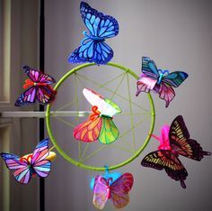 """Butterfly Craft """"""""""""I used a few things that I'd found in thrift stores to put it together. The main ring was part of a medium sized embroidery hoop that I wrapped in green cotton yarn."""""""""""""""