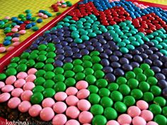 Use M&M's to top your cake with a pattern. | 28 Insanely Creative Ways To Decorate A Cake That Are Easy AF