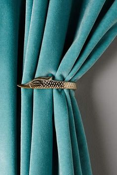 This graceful creature lends its lengthy neck to keeping curtains in order. Curtain Styles, Curtain Designs, Home Curtains, Curtains With Blinds, Classic Decor, Turquoise Curtains, Curtain Hardware, Curtain Accessories, Home And Deco