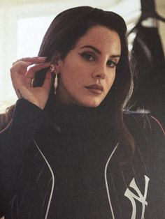 born to adore Lana Del Rey // Lana showing off her earrings