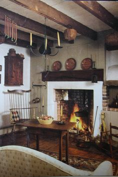 Love the redware, beams, candles, windsor chair - love it all