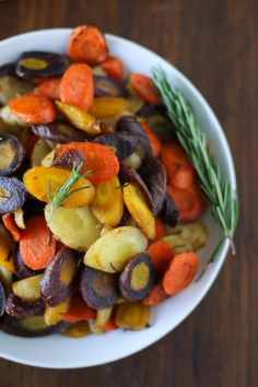 Rainbow roasted carrots are an easy and flavorful side dish. You can roast them with your favorite spices, or try them with rosemary, cumin, and cinnamon. Healthy Side Dishes, Veggie Dishes, Side Dish Recipes, Vegetable Recipes, Vegetarian Recipes, Cooking Recipes, Healthy Recipes, Carrot Recipes, Primal Recipes