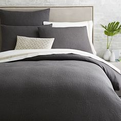 The Organic Medallion Matelasse Duvet's textured diamond pattern combines the relaxed appeal of a classic quilt with the sumptuous feel of crisp organic cotton. In slate, it offers an ideal base for layering on pillows and throws.