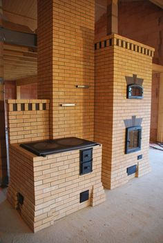 Lovely masonry heater, cooking stove and oven in one!