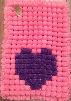 pink and girly pom pom blanket