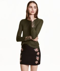 Check this out! Soft sweater in knit fabric with a sheen. Lace insert at back and wide lace trim at cuffs. - Visit hm.com to see more.