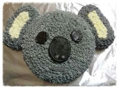 My daughters birthday cake! One round cake, 5x muffins (4 whole, 1 in quarters) for ears. Very easy Koala cake!