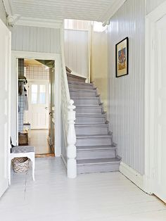 Love the faded denim blue stairs and pale blue walls...simple and clean, with white. Smögen, Sweden