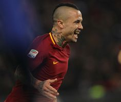 Radja Nainggolan of AS Roma celebrates after scoring the team's second goal during the Serie A match between AS Roma and SS Lazio at Stadio Olimpico on November 18, 2017 in Rome, Italy. - 70 of 243