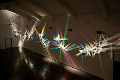 Stephen Knapphas been making work that is transformed by light for over thirty years, producing vibrant light installations he refers to as paintings. These large-scale works utilize minimal tools, harnessing simply light and dichroic glass to throw a multitude of colors against the walls and r