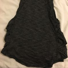Lululemon Var-City Muscle Tank Dark grey lululemon var-city muscle tank. Worn and washed a few times but still in great condition! Size 6. lululemon athletica Tops Tank Tops
